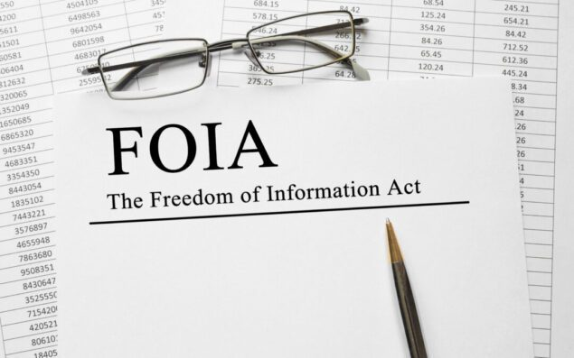 Paper with The Freedom of Information Act (FOIA) on a table